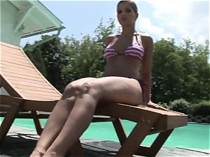 Roasting Eve Angel flashes off her jaw-dropping body pool side