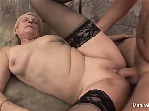 older grandmother takes a gash drilling on the bed