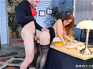 Dani Jensen toying with bone in the office