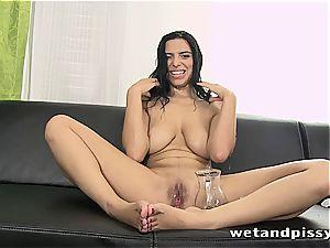 buxom Elena Rae pees through her pantyhose
