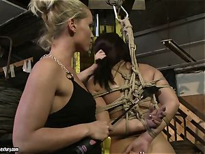 Kathia Nobili smacking the bootie of super-fucking-hot female with whip