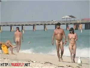 An utterly alluring nude beach spycam flick